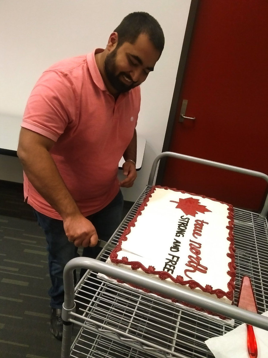 Rushin cuts his cake celebrating permanent residency
